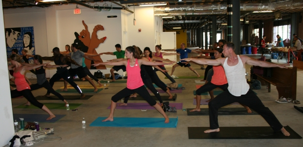Bendy Brunch participants practice yoga among art at the old Wonder Bread Factory. (Photo: Mark Heckathorn/DC on Heels)