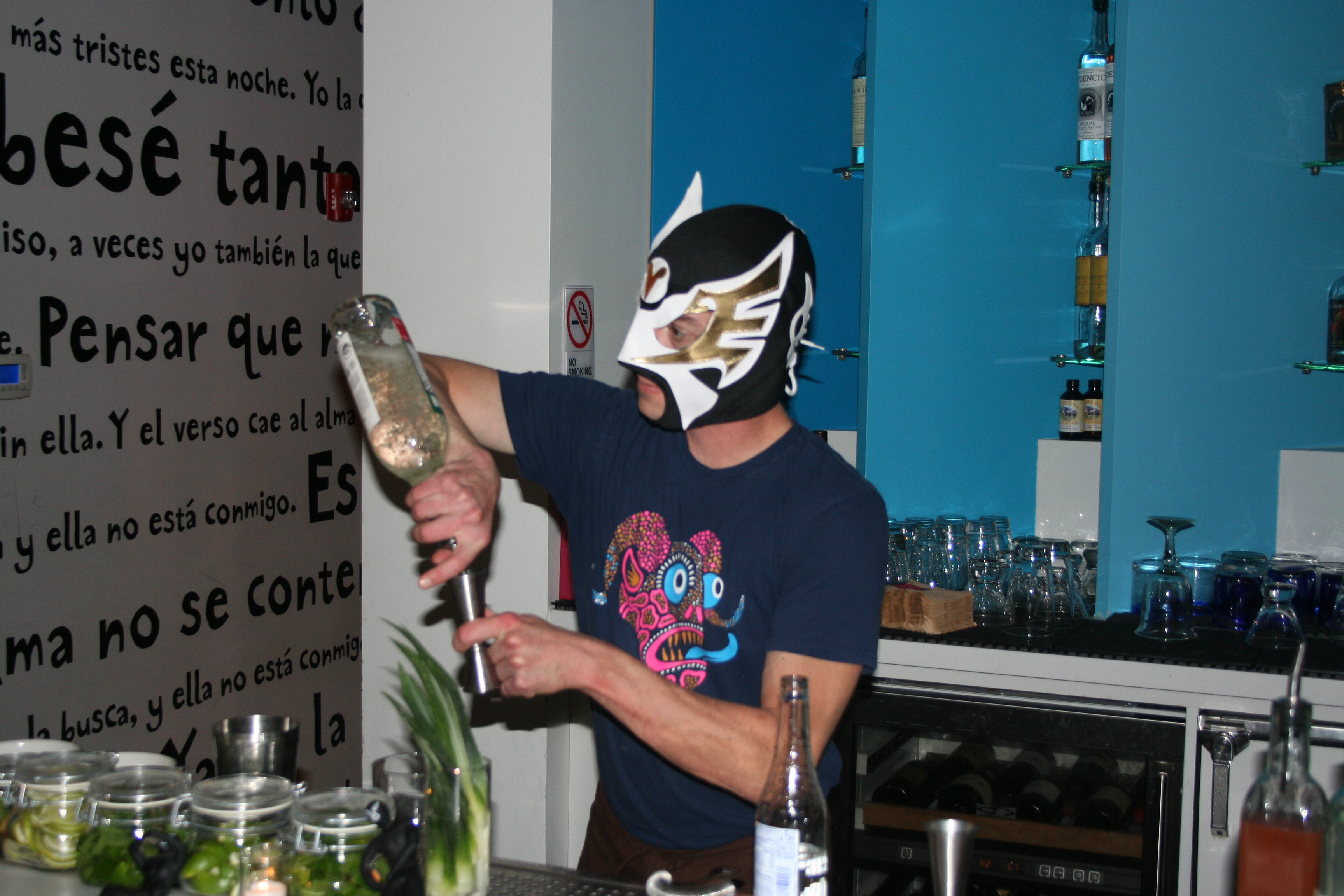 One of Oyamel's bartenders wears a mask while he mixes tequila drinks. (Photo: Mark Heckathorn/DC on Heels)