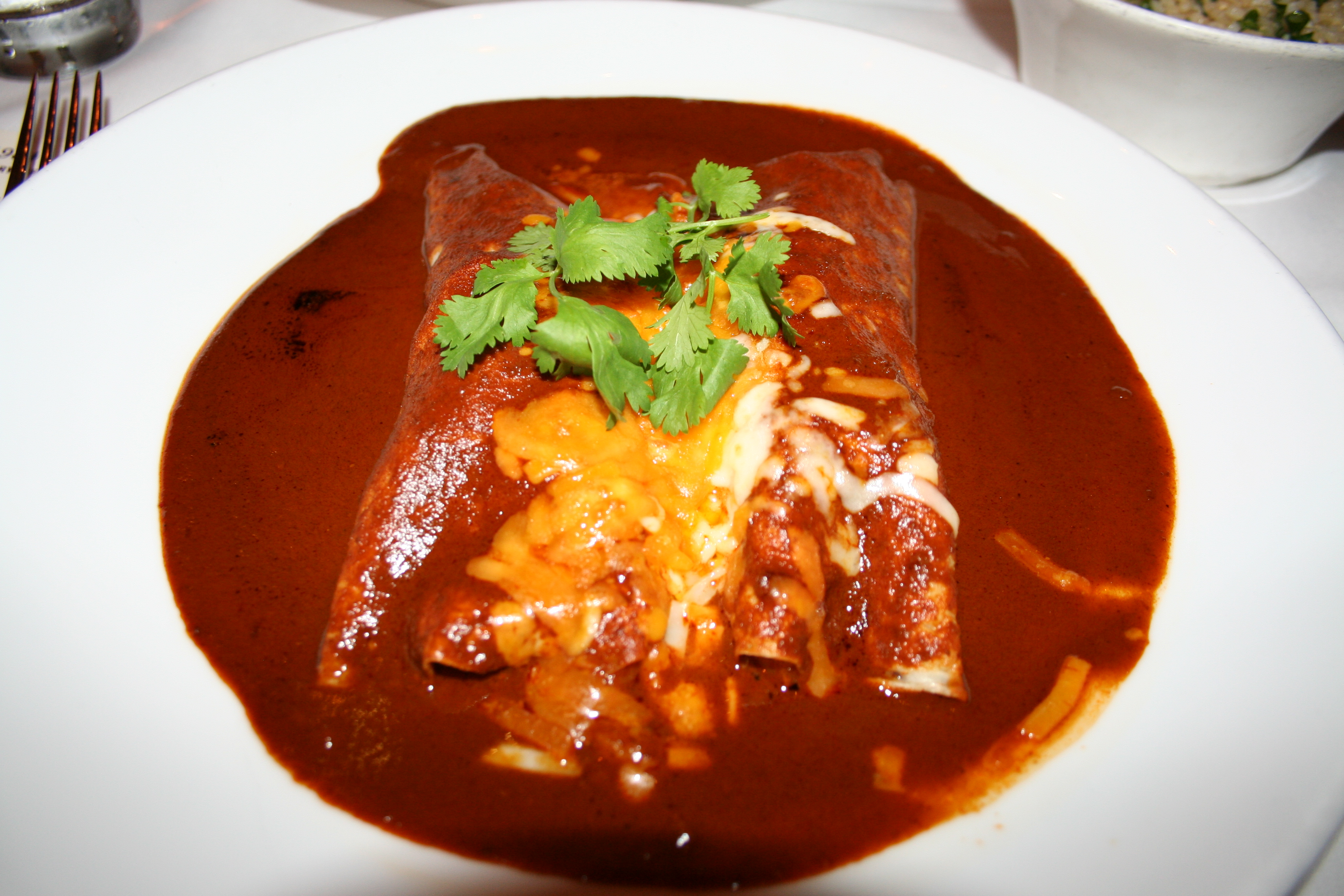 Crepes filled with shrimp and covered with chile pasilla sauce. (Photo: Mark Heckathorn/DC on Heels)