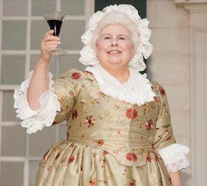 Martha Washington raises a glass of wine. (Photo: Mount Vernon)
