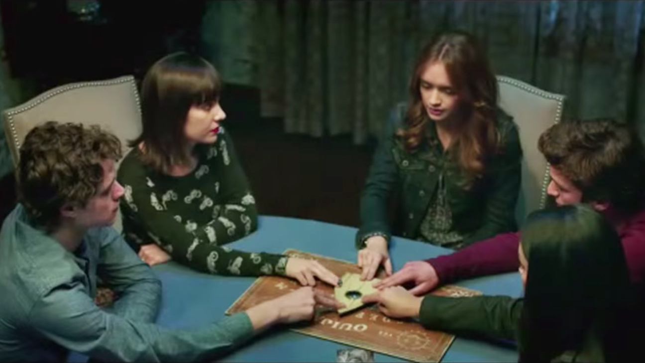 """Five teens contact evil spirits that killed their friend using a ouija board  in """"Ouija."""" (Photo: Universal Pictures)"""