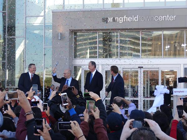 Mitchell Schear of Vornado joins other officials to cut the ribbon on the Springfield Town Center as confetti flies. (Photo: Michael Neibauer)