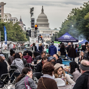 Diners enjoy their food on Pennsylvania Avenue at Taste of D.C. (Photo: Taste of D.C.)