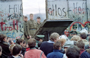 West Berliners crowd in front of the Berlin Wall early Nov. 11, 1989 as they watch East German border guards demolishing a section of the wall in order to open a new crossing point between East and West Berlin, near Potsdamer Square. (Photo: Getty Images)