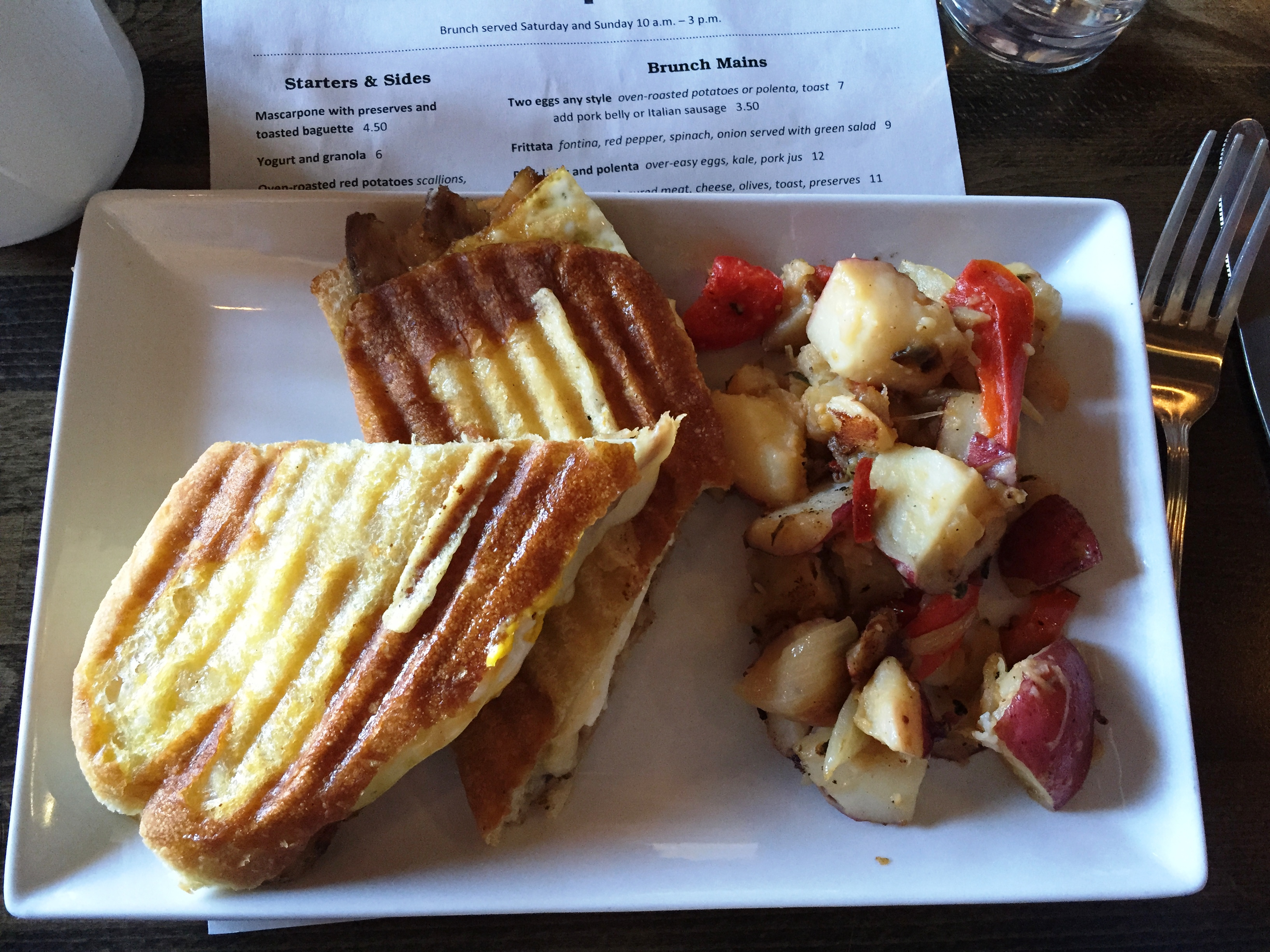 Pork belly panini with a side of roasted potatoes. (Photo: Lanna Nguyen/DC on Heels)
