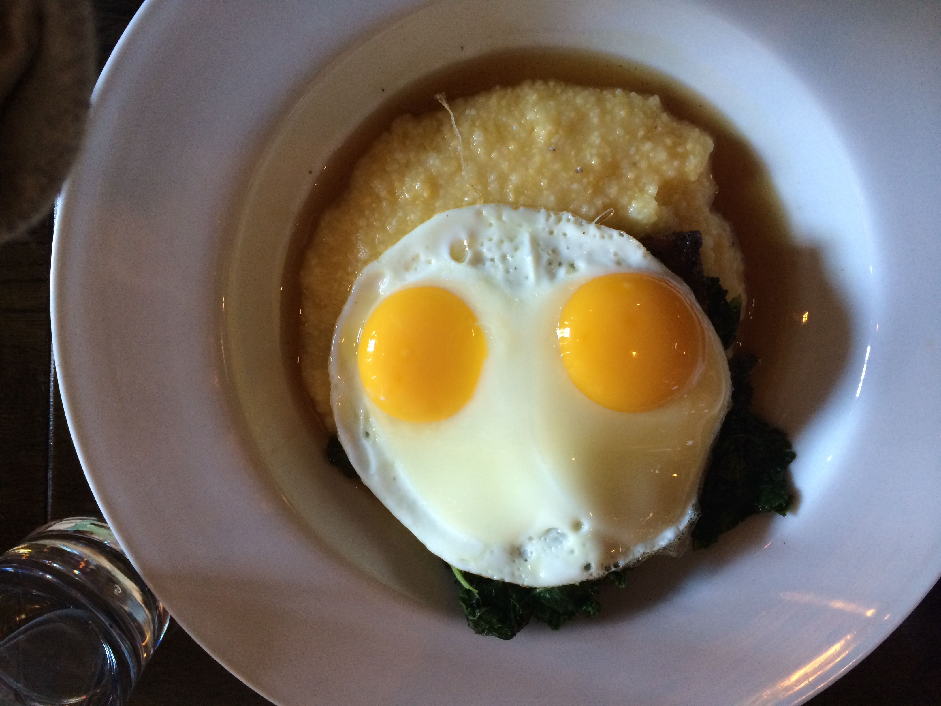 Pork belly and polenta with two eggs. (Photo: Lanna Nguyen/DC on Heels)