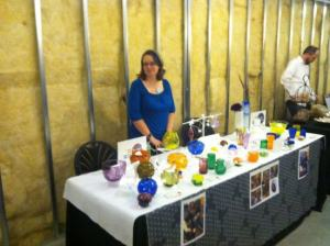 A vendor sells her glassware at last year's Made in D.C. Marketplace. (Photo: Think Local First)