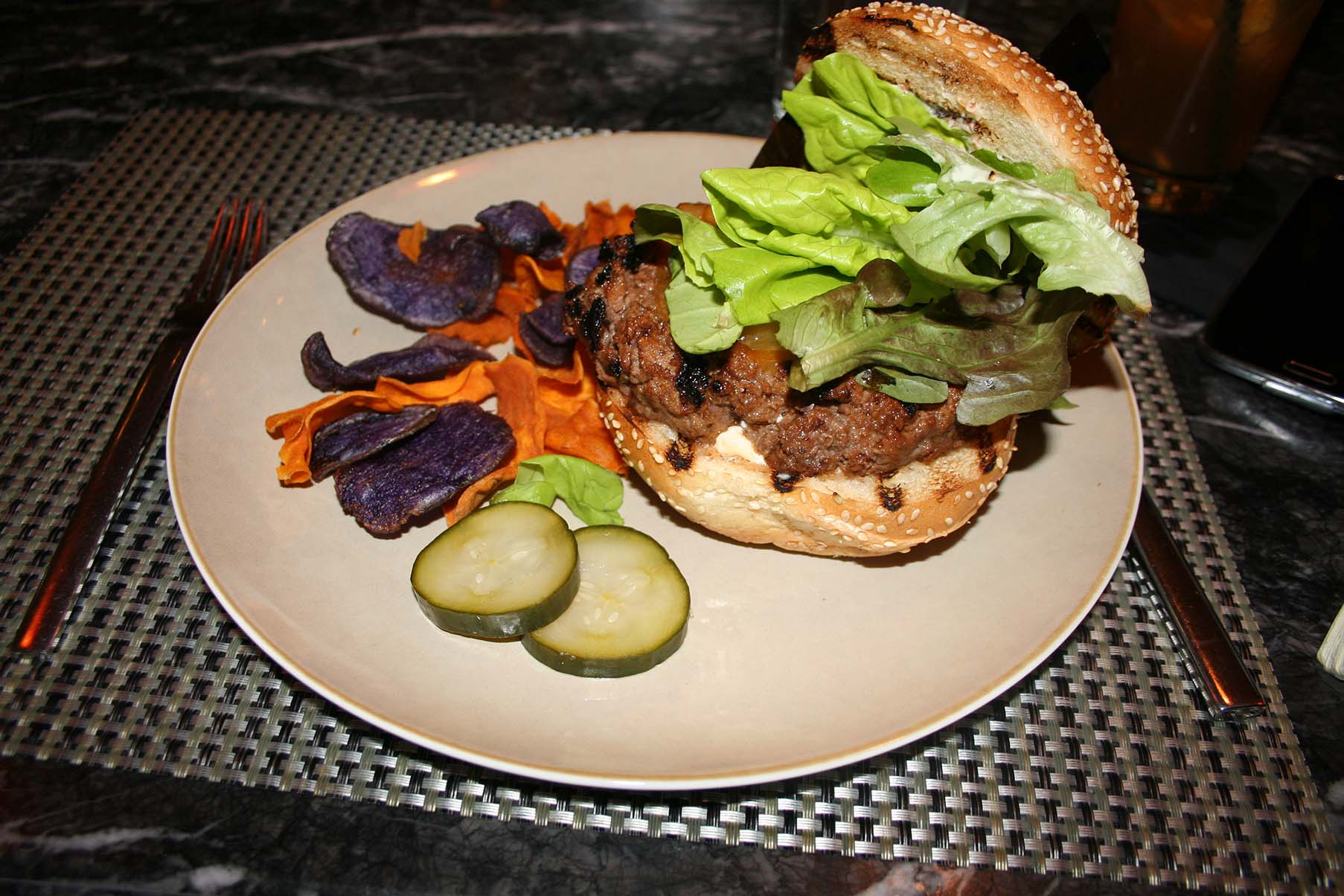 Equinox's grilled angus beef burger with cheddar cheese. (Photo: Mark Heckathorn/DC on Heels)
