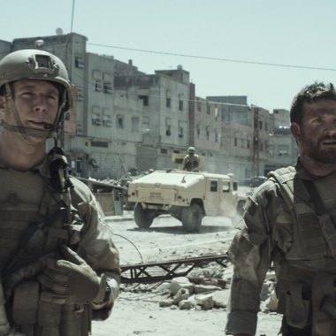 Jake McDorman as Biggles and Bradley Cooper as Chris Kyle (L to R) in
