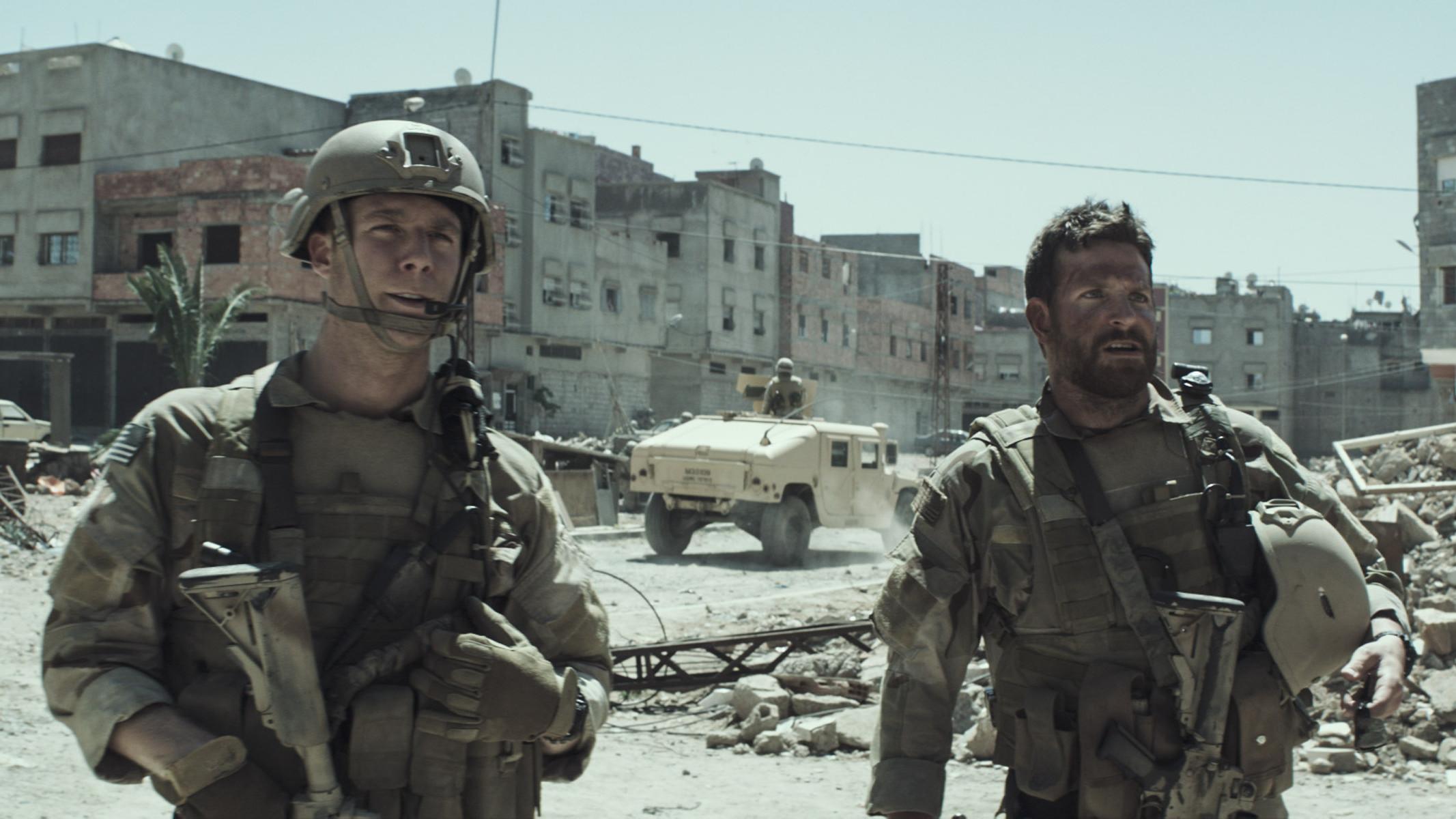 "Jake McDorman as Biggles and Bradley Cooper as Chris Kyle (L to R) in ""American Sniper."" (Photo: Warner Bros. Pictures)"