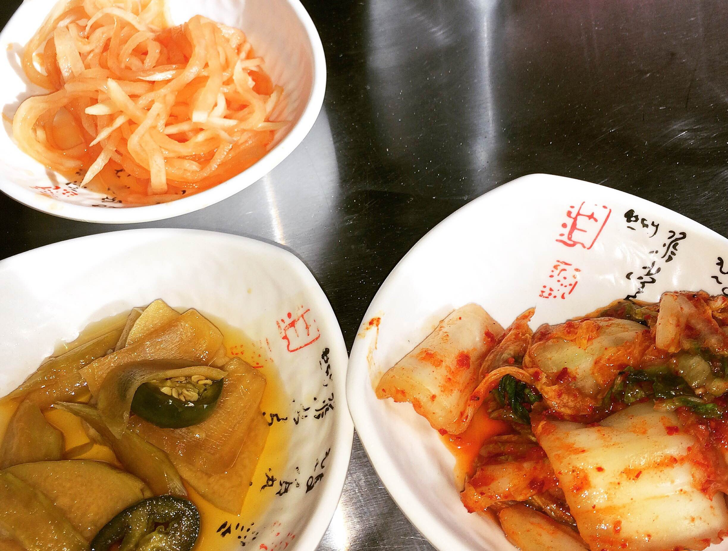 Banchan -- Korean side dishes included kimchi (right) a fermented cabbage and red chili dish. (Photo: Diana Veseth-Nelson/DC on Heels)
