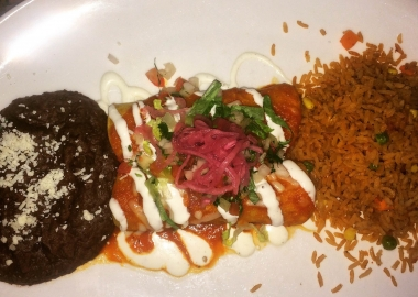 Beef brisket barbacoa enchiladas with refried beans and Mexican rice. (Photo: Diana Veseth-Nelson/DC on Heels)