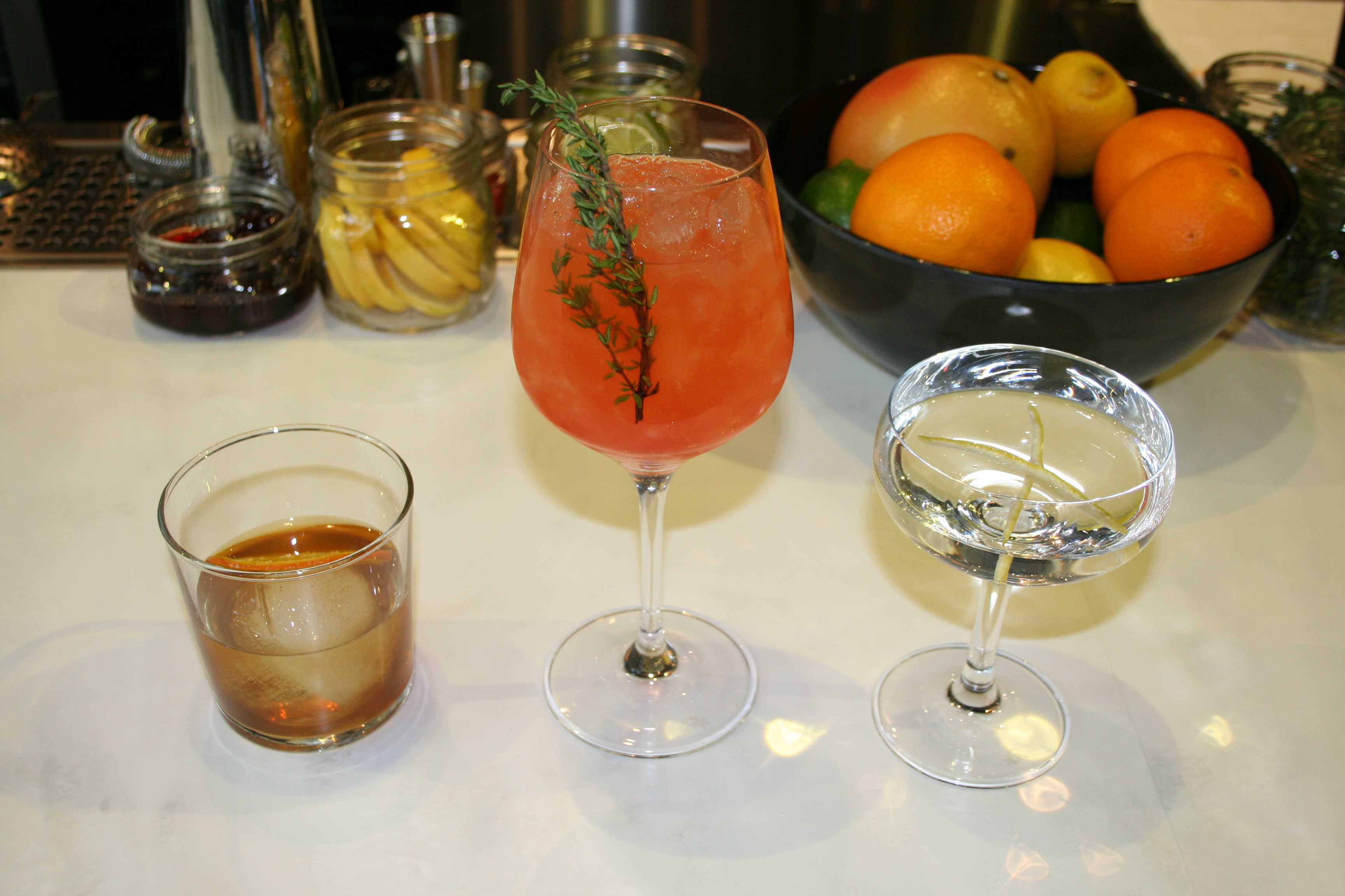 The cocktail program includes the Papa Bear(left) with rye, amaro, cinnamon raisins infused sweet vermouth, pimento bitters and alleppo; the Gracias Amigo (center) with tequila, aperol, grapefruit, agave and thyme; and the MIC Martini (right) with  vodka or gin, dolin blanc and orange bitter. (Photo: Mark Heckathorn/DC on Heels)