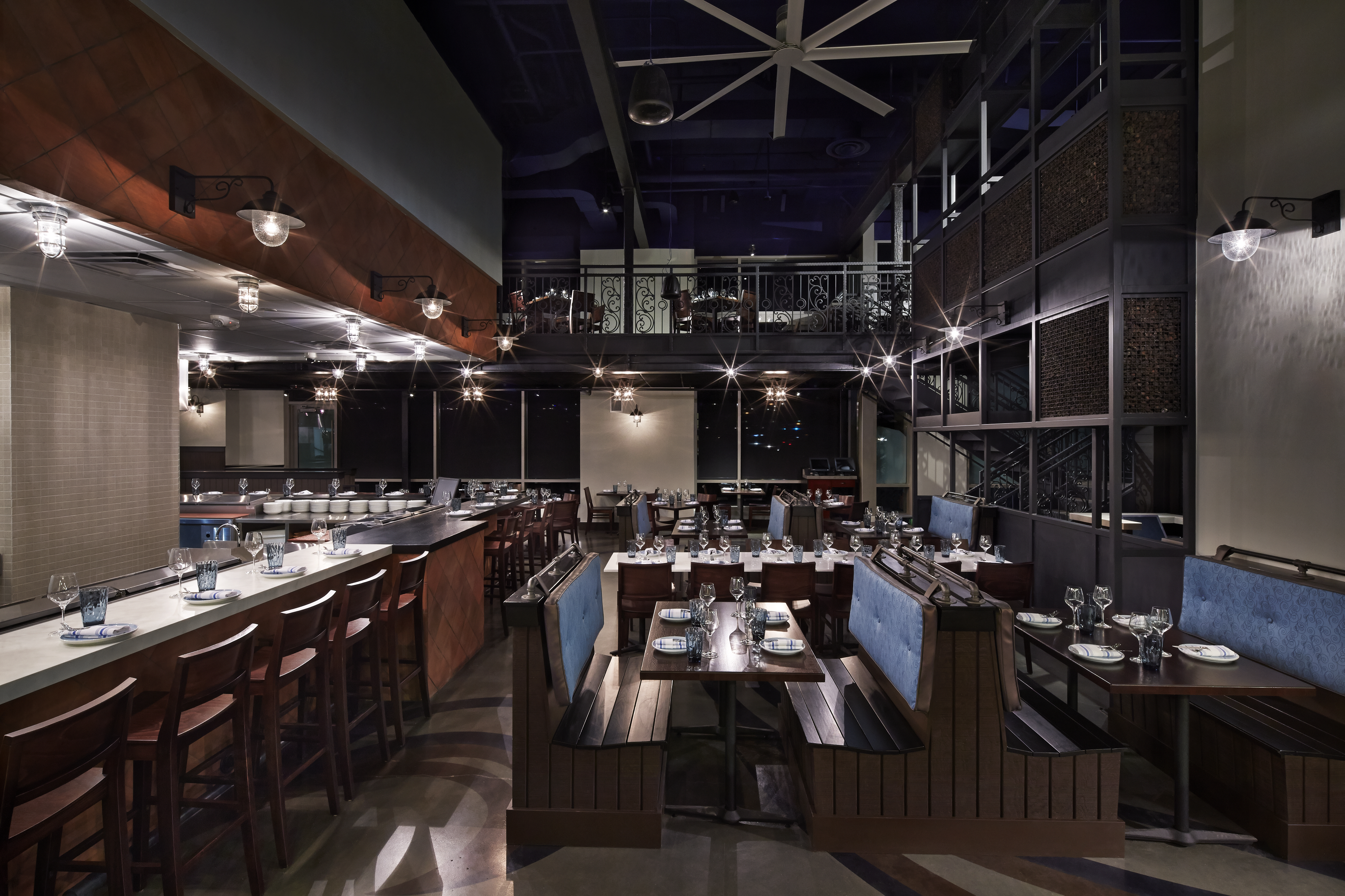 The interior is dark woods, terra cotta and blue with marble countertops. (Photo: Greg Powers/Kapnos Taverna)