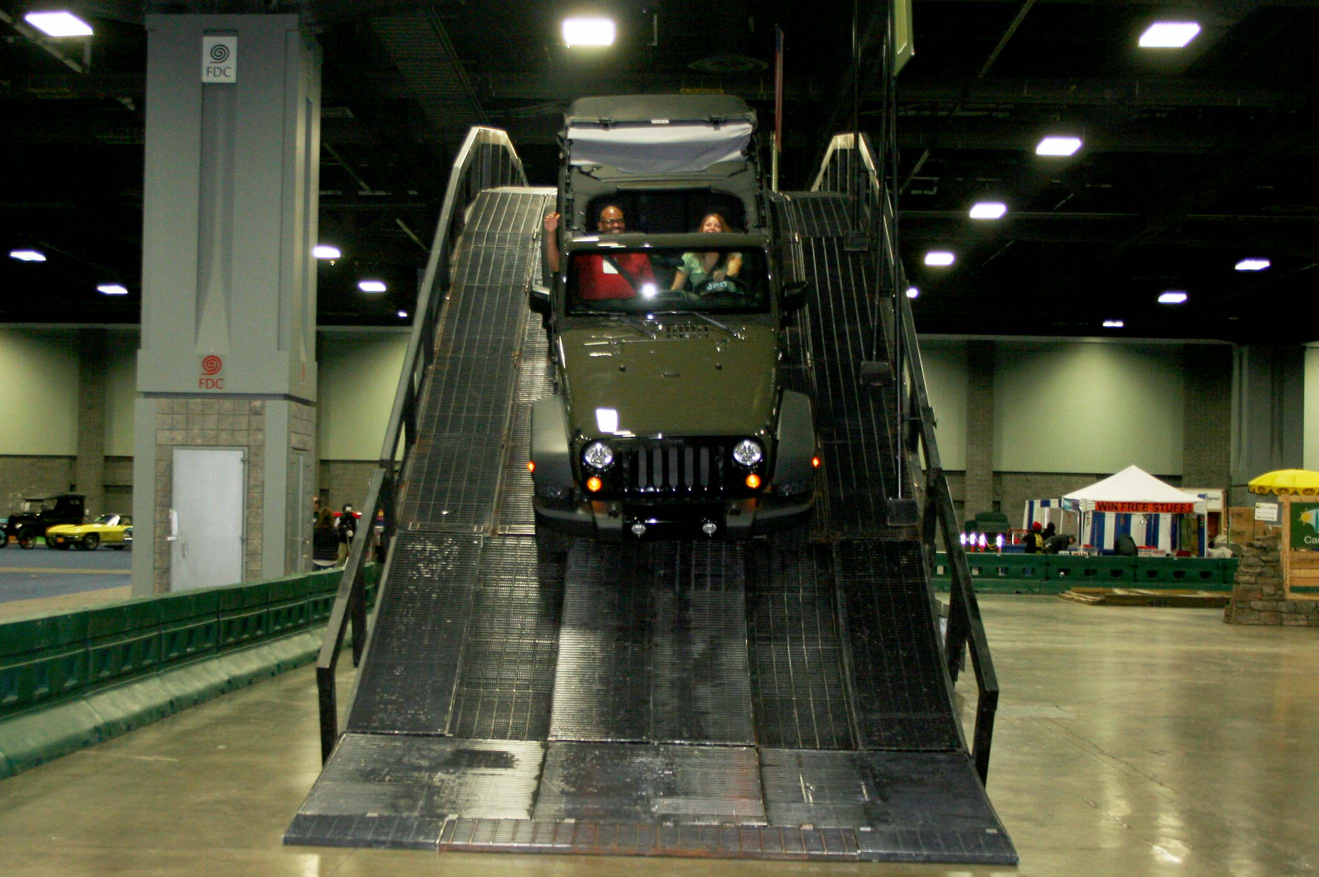 Nick Bullock, left, takes a ride with Haley Gauley in a 2015 Wrangler Unlimited on an off- road display called Camp Jeep at the Washington Auto Show. Gauley is a representative at the Jeep display. (Photo: Mark Heckathorn/DC on Heels)