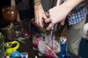 A bartender pours a drink at last year's Sips & Suppers. (Photo: Elizabeth Parker)