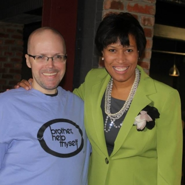 D.C. correspondence officer James Slatter and Mayor Muriel Bowser at Brother Help Thyself's recent grants ceremony at the D.C. Eagle. (Photo: David York/Facebook)
