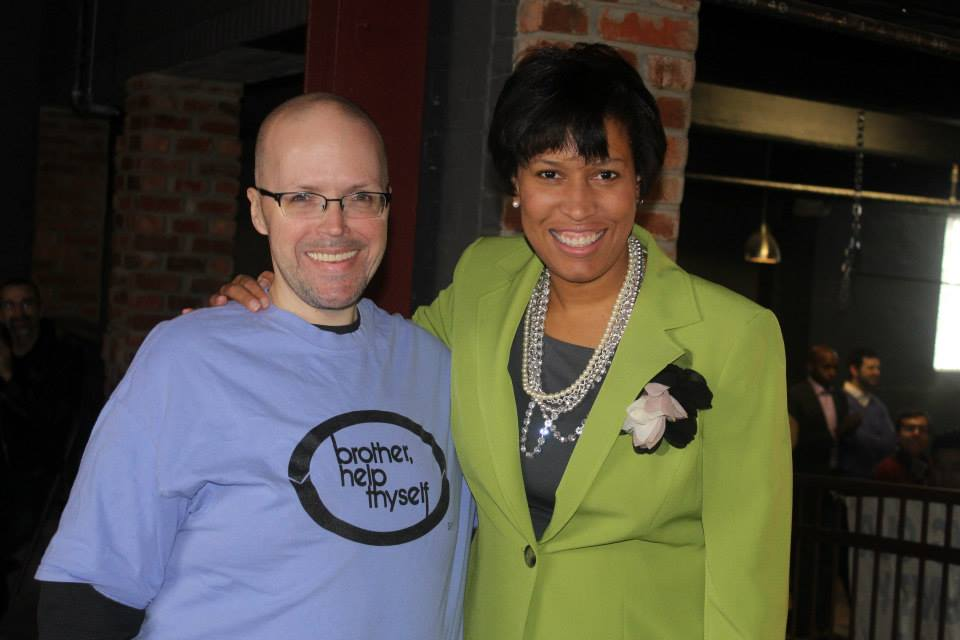 D.C. correspondence officer James Slattery and Mayor Muriel Bowser at Brother Help Thyself's recent grants ceremony at the D.C. Eagle. Bowser pays Slattery $90,000 to open her mail.(Photo: David York/Facebook)