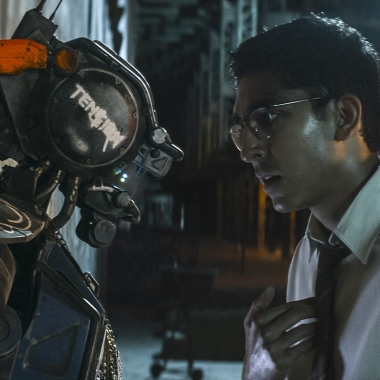 CHAPPiE (Sharlto Copley, left) and his creator Deon (Dev Petal) in CHAPPiE. (Photo: Sony Pictures)
