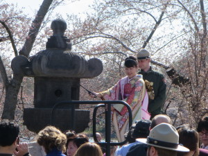 Hikari Nishimoto, Embassy of Japan Cherry Blossom Princess, lights the Japanese Stone Lantern during the 2014 ceremony. (Photo: Ryan Janek Wolowski/Flickr)