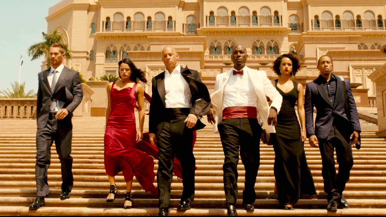 "The cast of ""Furious 7"" includes the late Paul Walker (l to r), Michelle Rodriguez, Vin Diesel, Tyrese Gibson, Nathalie Emmanuel and Ludacris. (Photo: Universal Pictures)"