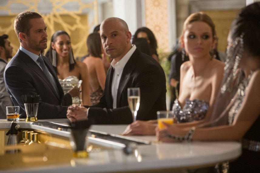 """Furious 7"" with the late Paul Walker (left) and Vin Diesel remained on top at the box office for the fourth consecutive week. (Photo: Universal Pictures)"