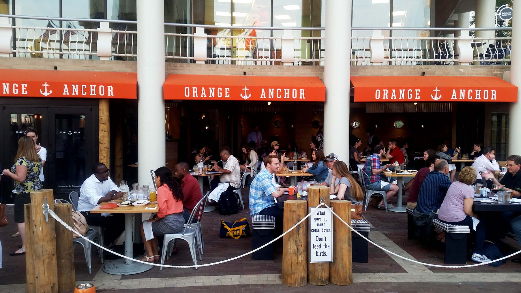 Diners eat on the Orange Anchor patio at Washington Harbor. (Photo: Mark Heckathorn/DC on Heels)