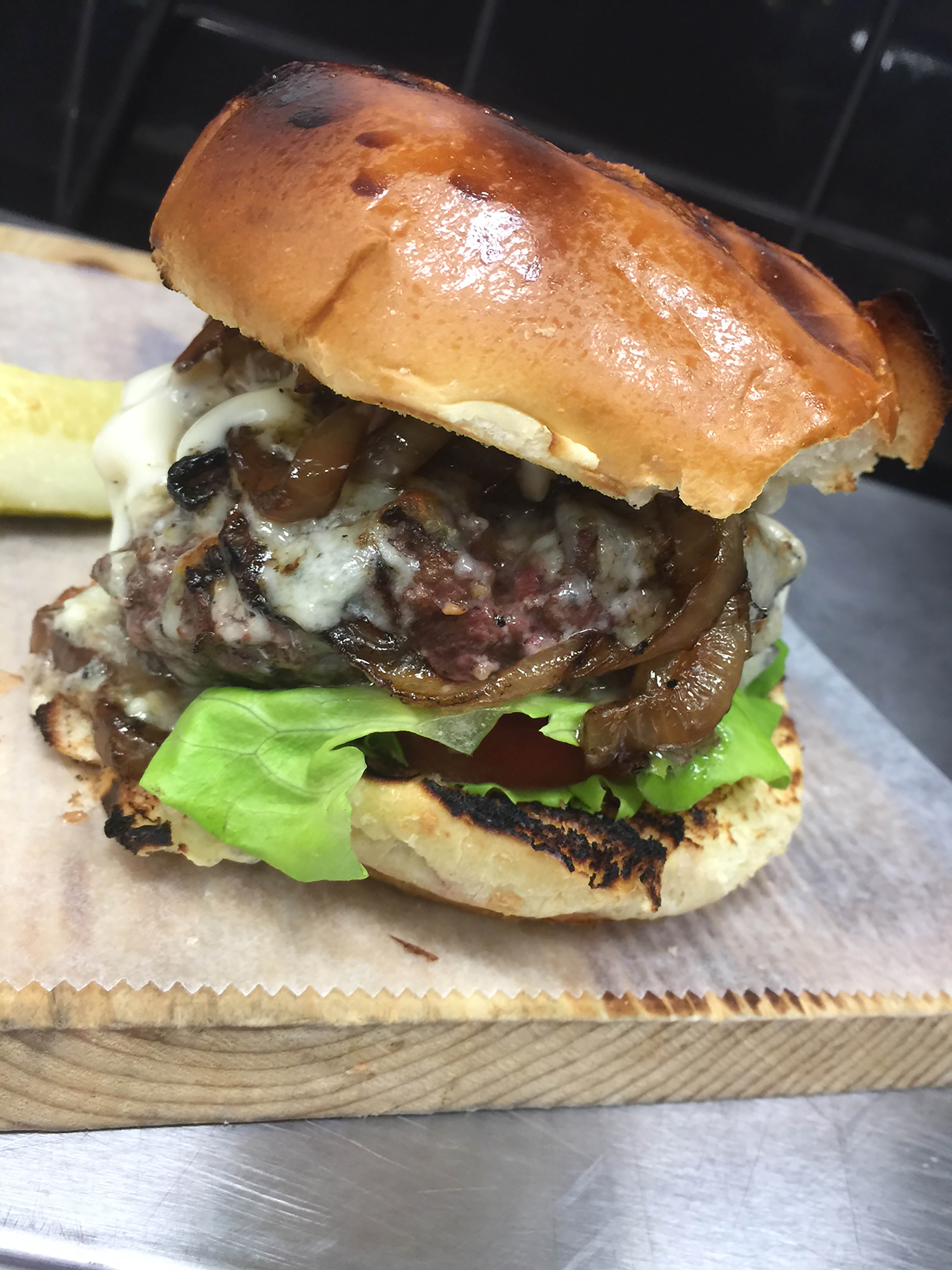 Station 4 is offering 25 percent off its smoked Kobe-style burger on Thursday for National Burger Day. (Photo: Station 4)