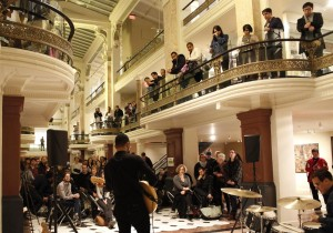 Concertgoers watch a band perform at a Luce Unplugged Community Showcase at the Smithsonian American Art Museum's Luce Foundation Center. (Photo: Smithsonian American Art Museum)