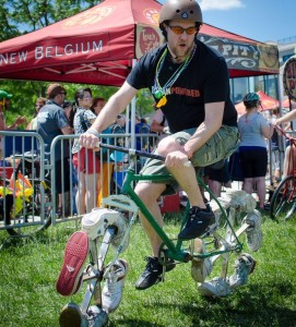 A bicyclist rides a bike with sneakers for wheels at last year's Tour de Fat. (Photo: New Belgium Brewing Co.)