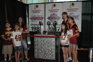 Fan's pose with the Redskins' three Super Bowl trophies at the 2014 draft day party. (Photo: Redskins)