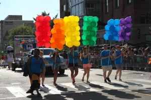 Marchers in last year's Capital Pride parade carry balloons in the rainbow colors. (Photo: S. Pakhrin)
