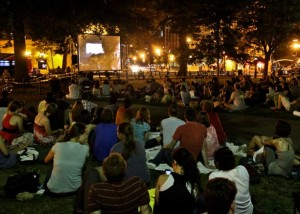 Viewers watch a movie on video screen in Dupont Circle Park. (Photo: Borderstan)