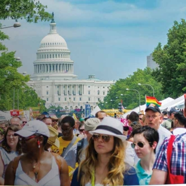 Visitors to the 2014 Pride festival visit booths set up along Pennsylvania Avenue. (Photo: Tim Evanson)