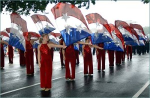 A flag line marches in the National Independence Day Parade. (Photo: National Independence Day Parade)
