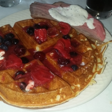 A made-to-order Belgian waffle with berry topping and rosemary crusted top round with horseradish sauce. (Photo: Mark Heckathorn/DC on Heels)