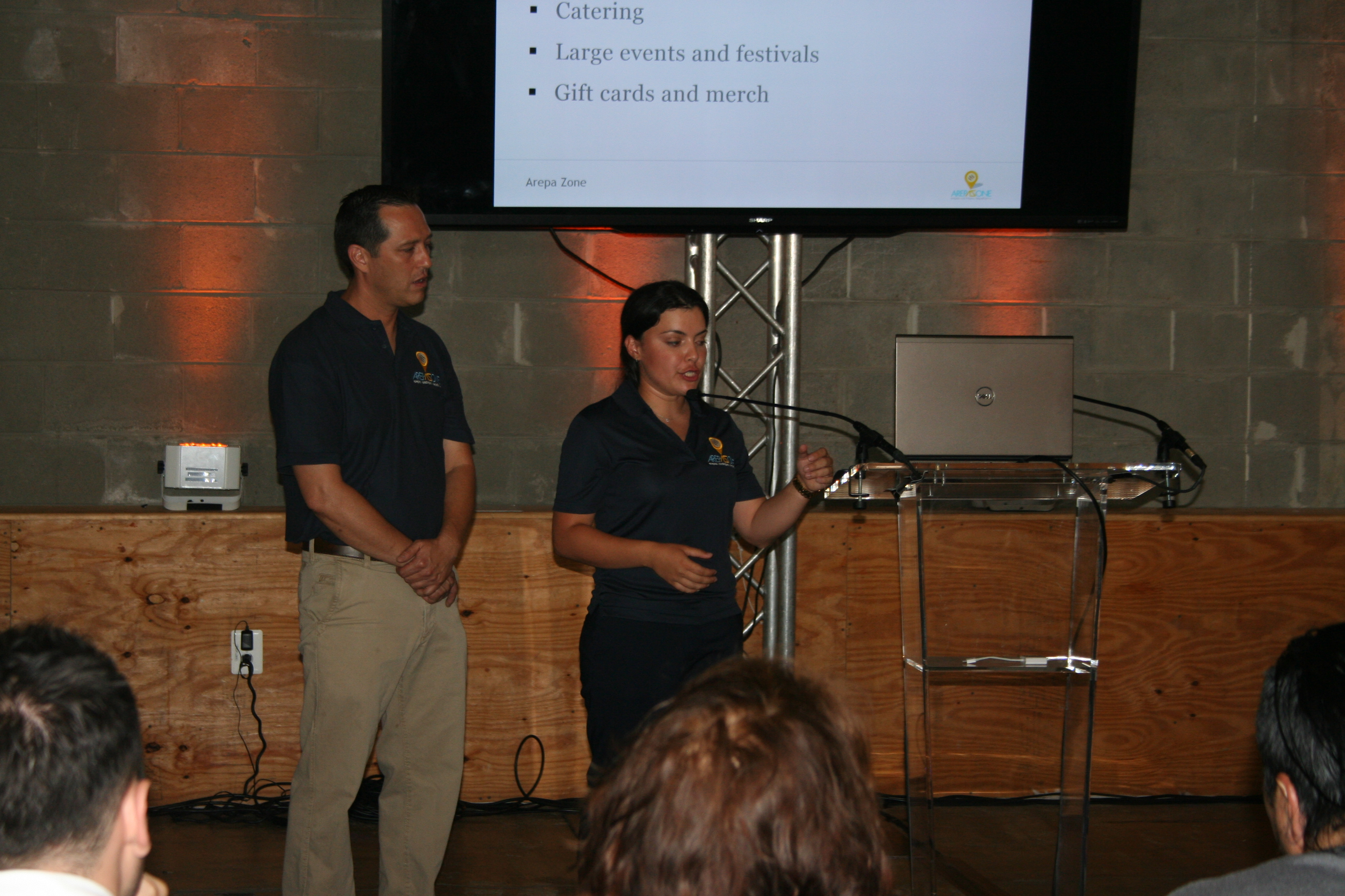 Ali Arellano and Gaby Febres give their 5-minute presentation to Launch Pad judges. (Photo: Mark Heckathorn/DC on Heels)