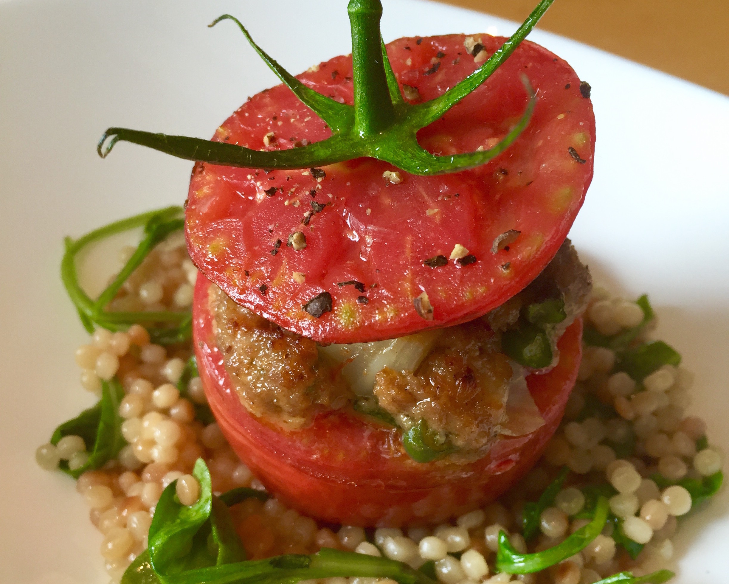 Stuffed tomatoes with pearl pasta are part of Central's special summer tomato week menu. (Photo: Central)