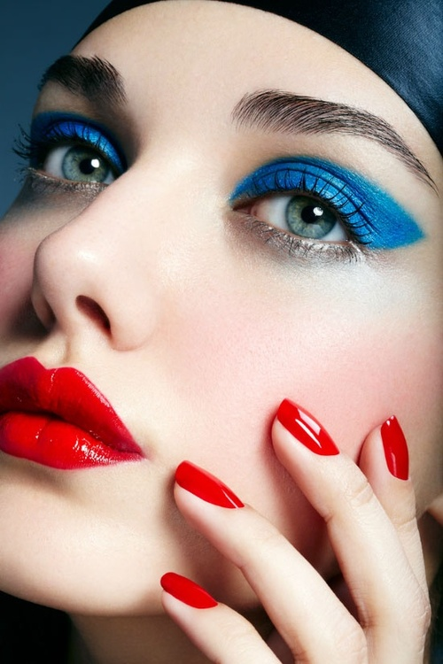 Pair red lips with blue eyeshadow for the perfect Fourth of July look (Photo: Pinterest)