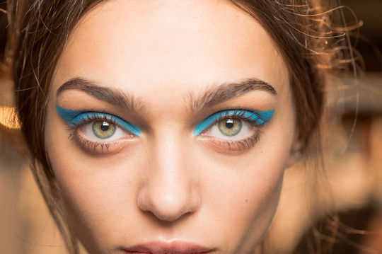 A boldly curved graphic cat eye in blue ruled the spring/summer runways. (Photo: Mark Leibowitz)