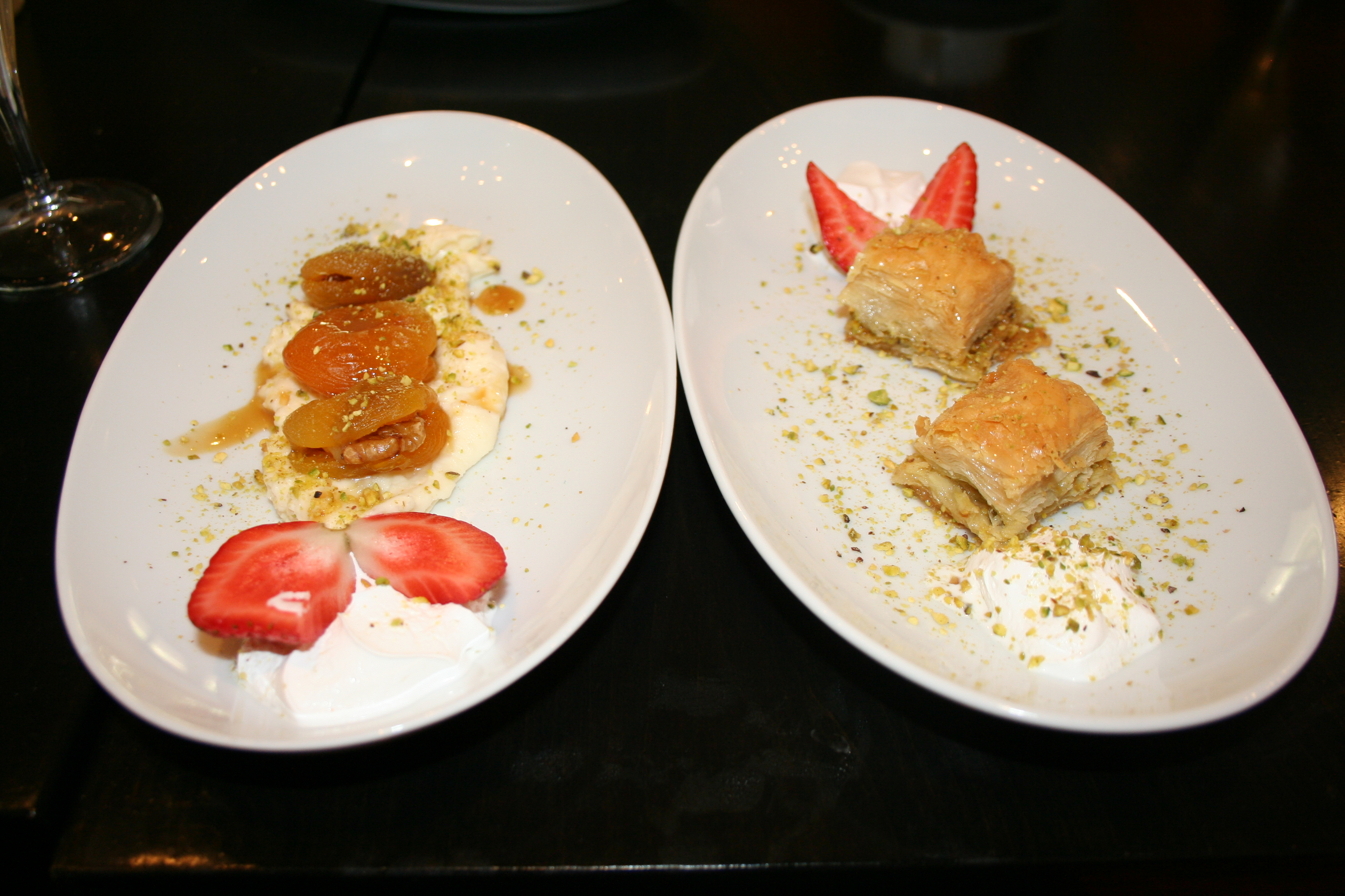 Decadent desserts include apricots stuffed with creme and topped with pistachios (left) and baklava. (Photo: Mark Heckathorn/DC on Heels)