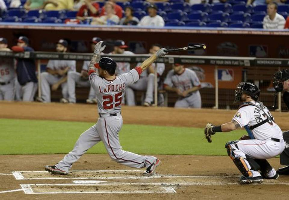 Adam LaRoche (25) follows through on a two-run home run against the Miami Marlins last year. (Photo: Alan Diaz/AP)