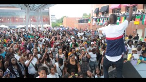 Visitors to Silver Spring's FestAmerica! watch Eddy Kenzo perform. (Photo: Eddy Kenzo)