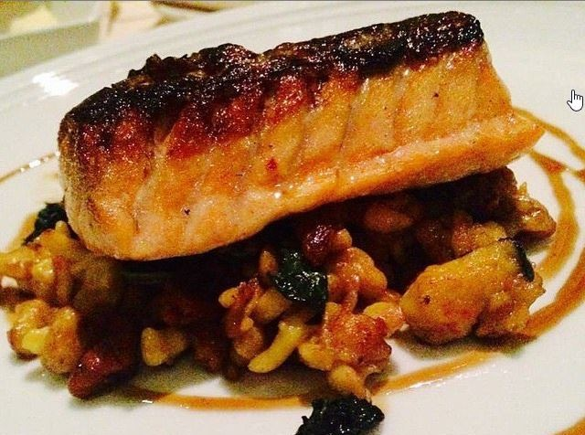 701 Restaurants entrees include roasted salmon with popcorn puree, trumpet mushrooms, fennel and blueberry kosho. (Photo:EventsDC)