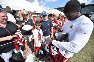 Fans collect autographs at Redskins training camp, which wraps up this weekend. (Photo: Washington Redskins)