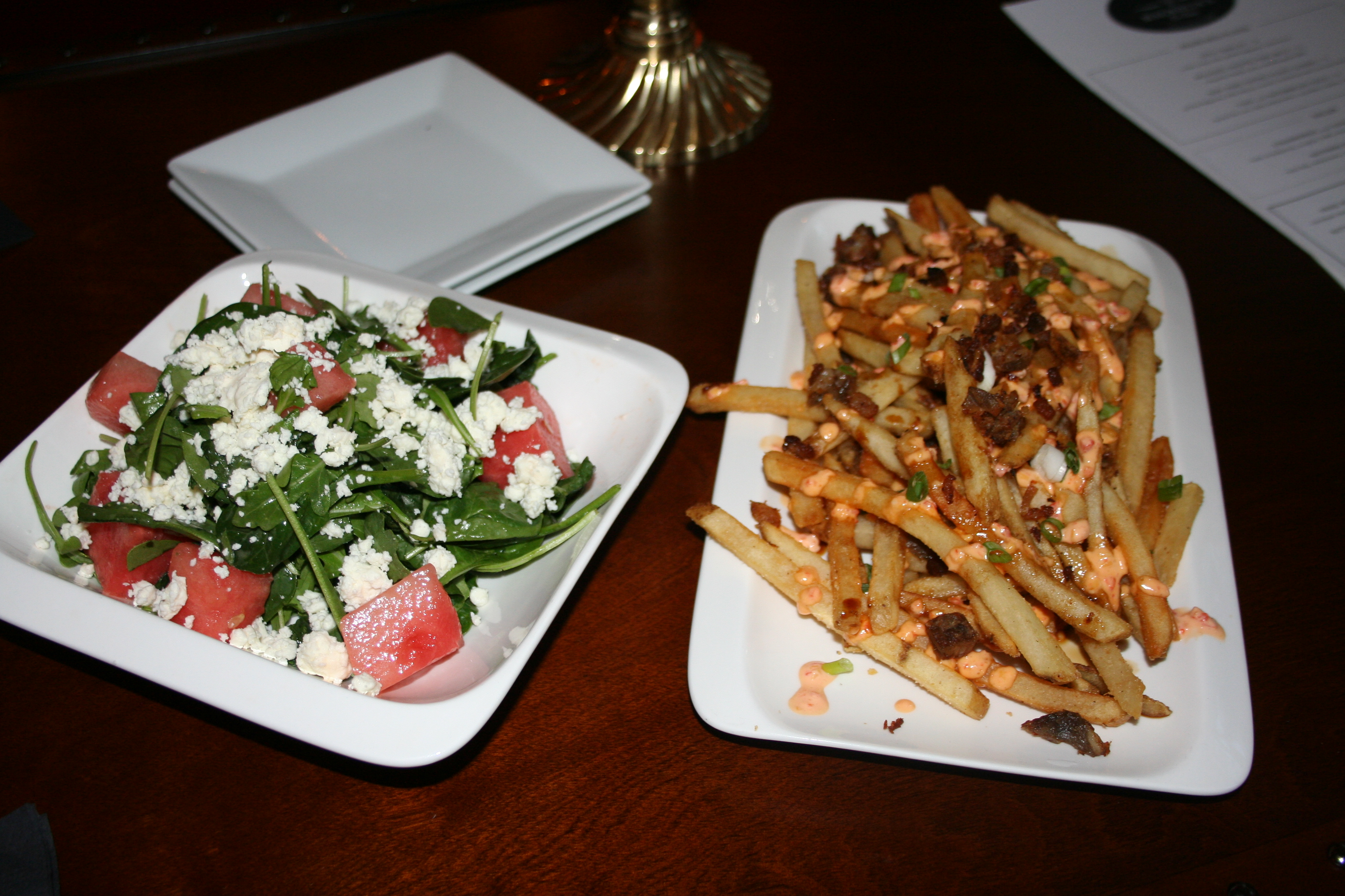 The watermelon and feta salad and pig fries are both great bar bites. (Photo: Mark Heckathorn/DC on Heels)