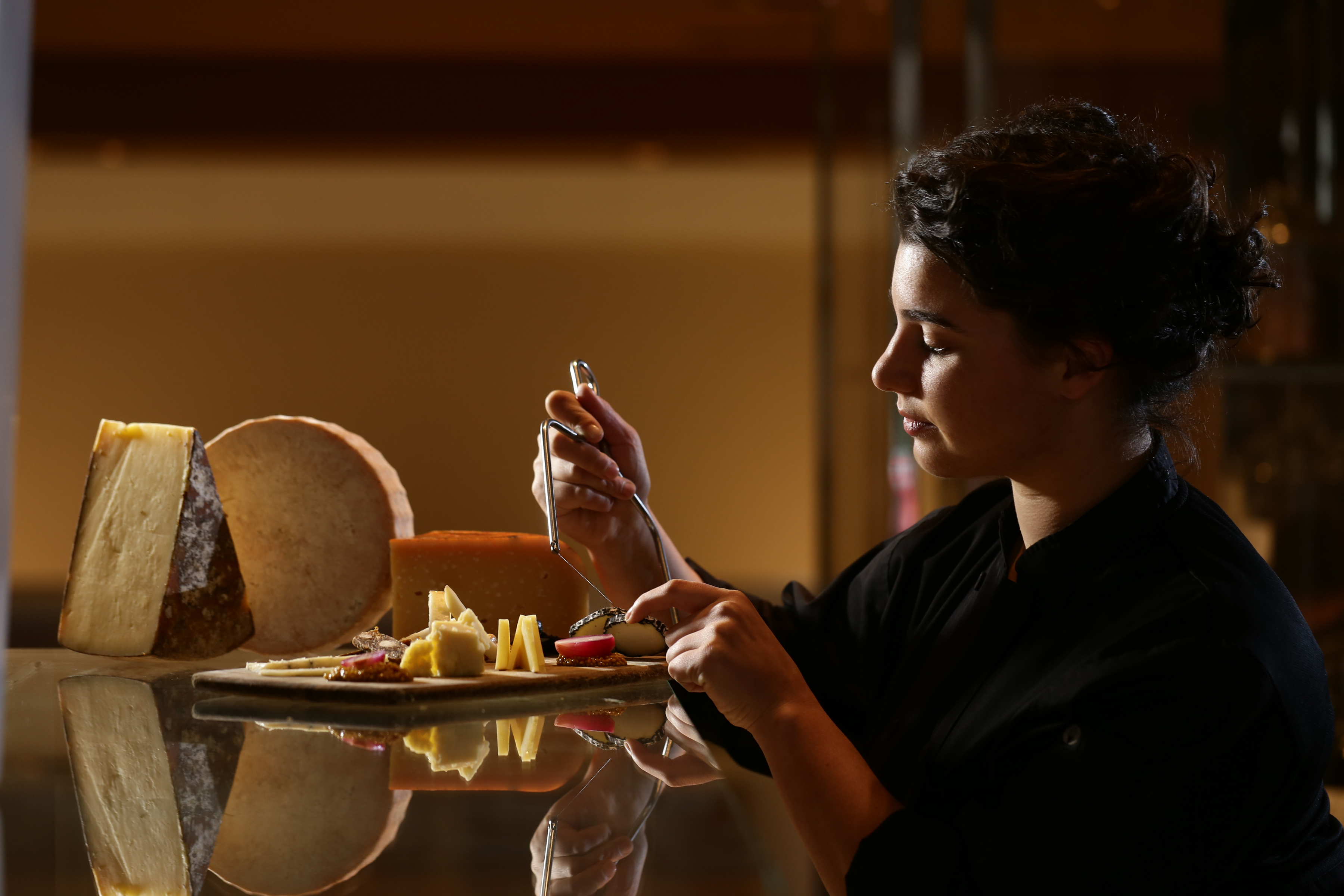 Blue Duck Tavern's cheese specialist Sophie Slesinger builds a cheese plate. (Photo: Len DePas Photography)