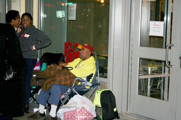 Jeff Cousins (seated) was the first customer in line, arriving at 12:45 a.m. Wednesday. (Photo: Mark Heckathorn/DC on Heels)