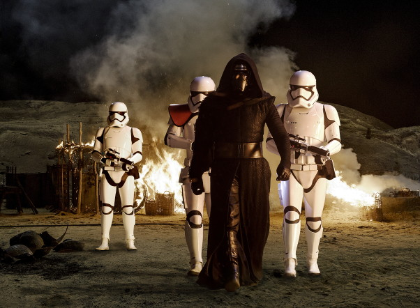 Kylo Ren (Adam Driver) with Stormtroopers in <em>Star Wars: The Force Awakens</em>. (Photo: David James/Lucasfilm)