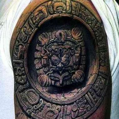 A 3D tattoo on someone's shoulder of an ancient Mayan carving. (Photo: Buzzy Tube)